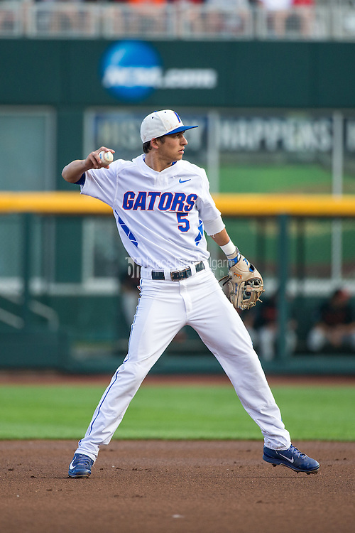 Dalton Guthrie (5) of the Florida Gators throws during a game between the Miami Hurricanes and Florida Gators at TD Ameritrade Park on June 13, 2015 in Omaha, Nebraska. (Brace Hemmelgarn)