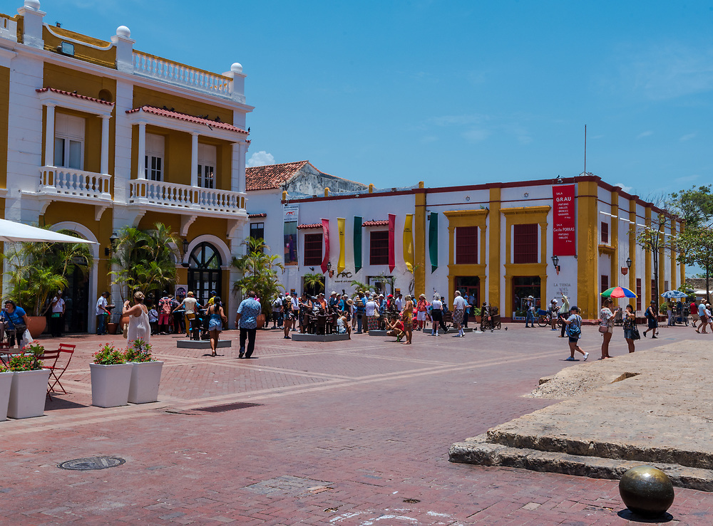 Cartagena, Columbia--April 21, 2018. People are walking about in front of a musem in a public square in Cartagene. Editorial use only.