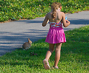 This young girl was mezmorized by the sight of this wild rabbit.