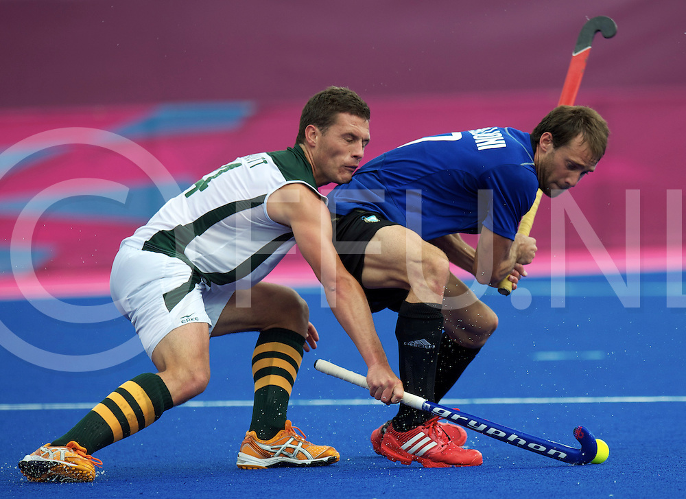 LONDON - Olympische Spelen 2012<br /> men match<br /> Argentina  v South Africa <br /> foto:  Rhett Halkett  duel with Facundo Callioni <br /> FFU PRESS AGENCY COPYRIGHT FRANK UIJLENBROEK