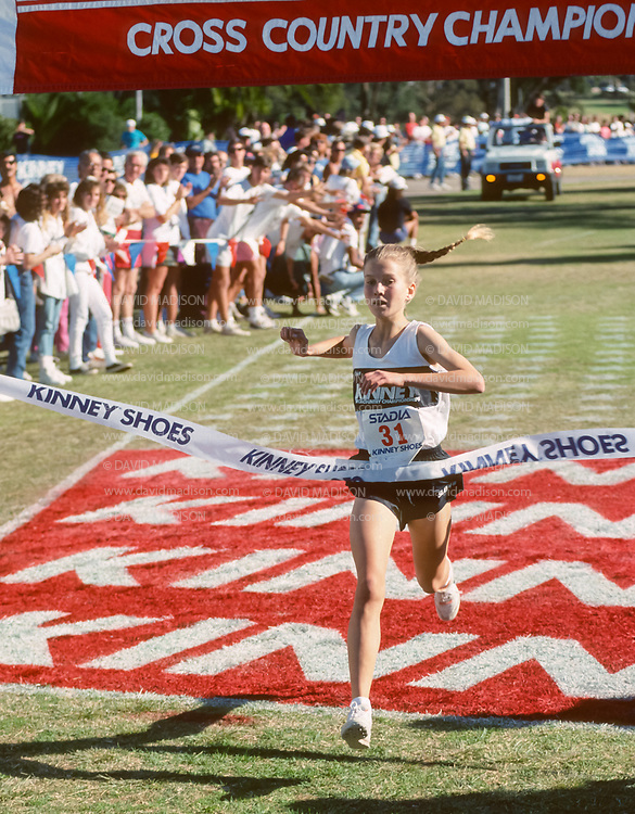 SAN DIEGO - DECEMBER 8:  Melody Fairchild #31 of the United States wins the 1990 Kinney Cross Country Championships on December 8, 1990 at Balboa Park in San Diego, California.  The meet later became known as the Foot Locker Cross Country Championships.  (Photo by David Madison/Getty Images)