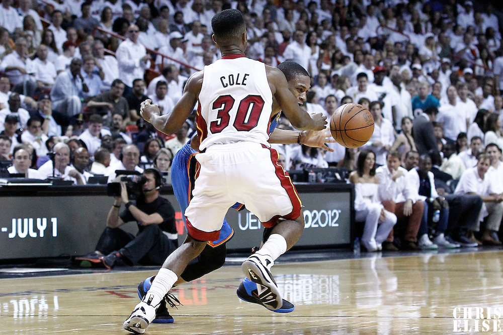 21 June 2012: Miami Heat point guard Norris Cole (30) defends on Oklahoma City Thunder point guard Russell Westbrook (0) during the Miami Heat 121-106 victory over the Oklahoma City Thunder, in Game 5 of the 2012 NBA Finals, at the AmericanAirlinesArena, Miami, Florida, USA. The Miami Heat wins the series 4-1.