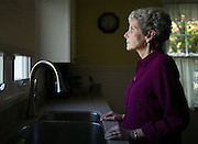 Linda Interlichia at her home in Rochester, New York on Friday, October 17, 2014. Mrs. Interlichia had a hysterectomy in 2013 that involved the use of a morcellator, which shreds the tissue into smaller pieces for less invasive removal. The tool also rapidly dispersed a previously undiscovered cancer throughout her body. CREDIT: Mike Bradley for the Wall Street Journal<br /> ROBOT