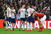 Goal - Callum Hudson-Odoi of England and other England players celebrate after Tomas Kalas of Czech Republic scored an own goal to give a 5-0 lead to the home team during the UEFA European 2020 Qualifier match between England and Czech Republic at Wembley Stadium, London, England on 22 March 2019.