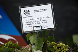 © Licensed to London News Pictures. 03/06/2018. London, UK. A note left on flowers from British Prime Minister Theresa May, marking one year since the London Bridge and Borough Market terror attacks. A series of events have taken place throughout the day, including a service of commemoration at Southwark Cathedral, the planting of an olive tree in the Cathedral grounds, a minute's silence at 4:30pm and the laying of flowers.  Photo credit : Tom Nicholson/LNP