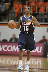 T. J. Bannister (15) sets the UVA offense against Virginia Tech.  The Wahoos beat the Hokies on their homecourt 54-49.