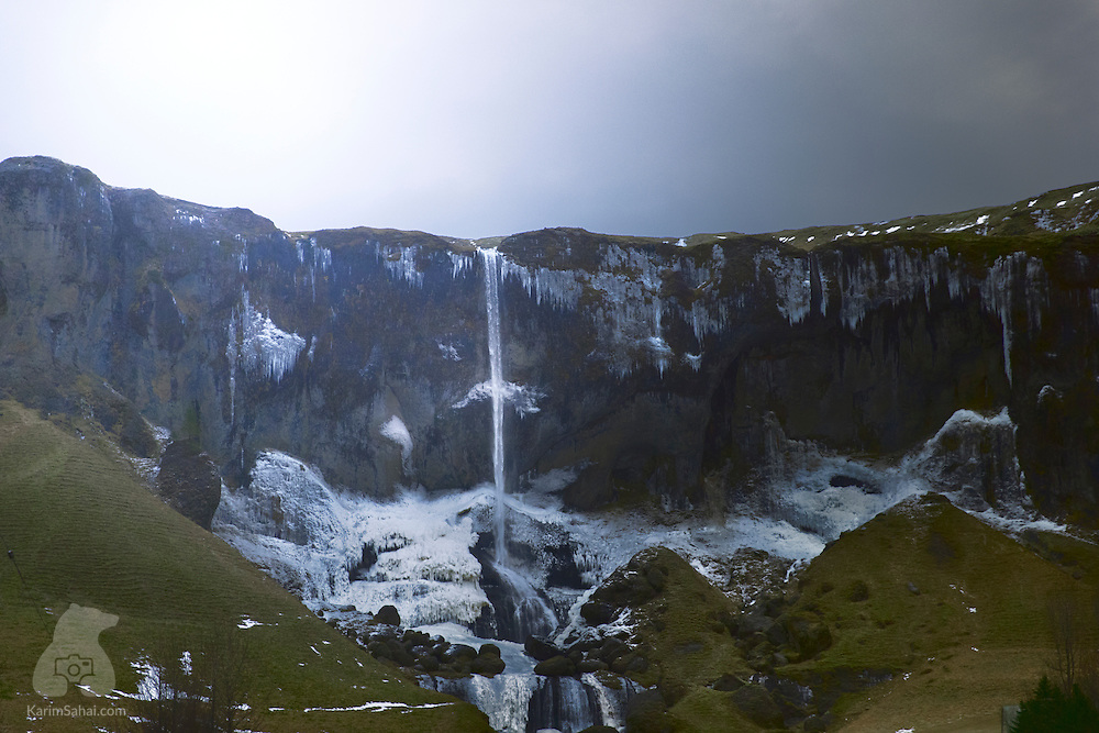 The thin 'Foss á Siðu' is a beautiful waterfall near the farming village of Kirkjubæjarklaustur, on Iceland's southern coast. The 30m tall waterfall overlooks farmland and runs off basalt cliffs. When it's windy (often!) you can sometimes see the water traveling upwards!