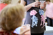 Pink and blue ribbons decorate Melissa Kennedy's stomach Sunday in Belgreen at her gender reveal party. The Kennedy's, like many other expecting parents, are excited for their baby's arrival, but in the meantime must find ways to deal with the limited access to health care for a pregnant woman.