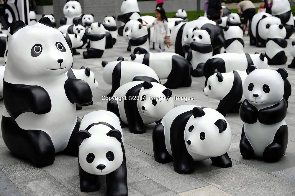 61633272<br /> Lovely pandas are seen during the 1St panda exhibition at Kerry Centre Square in Shanghai, East China, June 2, 2014. A total of 100 pandas made of leftover moso bamboos were displayed during the exhibition, Monday, 2nd June 2014. Picture by  imago / i-Images<br /> UK ONLY