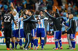 Diego Maradona (C) with Gonzalo Higuain and other players of Argentina celebrate after the 2010 FIFA World Cup South Africa Round of Sixteen match between Argentina and Mexico at Soccer City Stadium on June 27, 2010 in Johannesburg, South Africa. (Photo by Vid Ponikvar / Sportida)