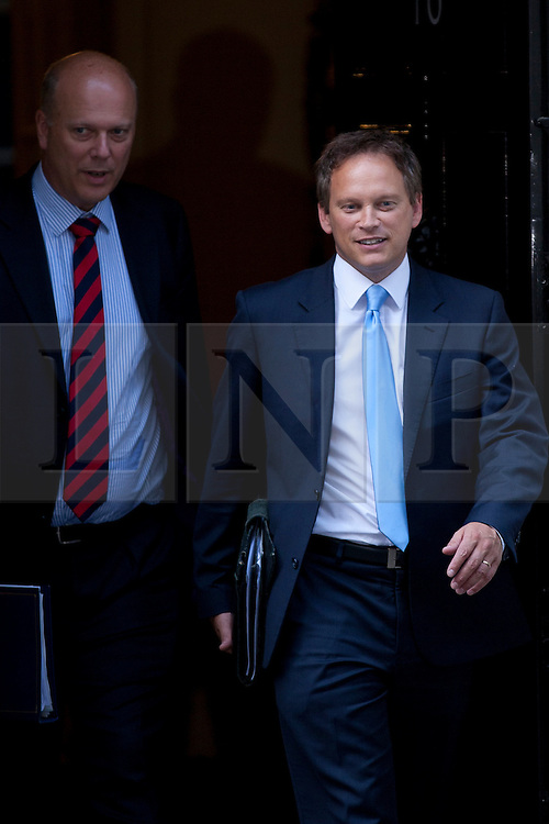 © Licensed to London News Pictures. 05/09/2012. LONDON, UK. Conservative Chairman Grant Shapps (R) and the Justice Secretary, Chris Grayling, are seen leaving Number 10 Downing Street in London today (05/09/12) after attending the first cabinet meeting after a cabinet reshuffle that took place yesterday (04/09/12).  Photo credit: Matt Cetti-Roberts/LNP