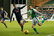 Brandon Barker (#20) of Hibernian crosses the ball beyond Jason Naismith (#3) of Ross County for Oli Shaw (#32) of Hibernian to score Hibernian's second goal (2-1) during the Ladbrokes Scottish Premiership match between Hibernian and Ross County at Easter Road, Edinburgh, Scotland on 23 December 2017. Photo by Craig Doyle.