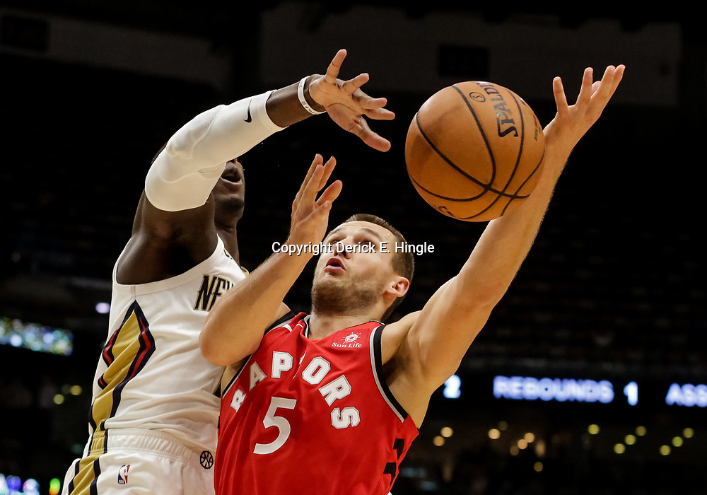 Oct 11, 2018; New Orleans, LA, USA; New Orleans Pelicans forward Cheick Diallo (13) blocks a shot by Toronto Raptors guard Kyle Collinsworth (5) during the second half at the Smoothie King Center. Mandatory Credit: Derick E. Hingle-USA TODAY Sports