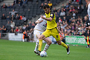 Scott Fraser (8) on the ball during the EFL Sky Bet League 1 match between Milton Keynes Dons and Burton Albion at stadium:mk, Milton Keynes, England on 5 October 2019.