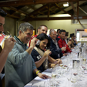 A group of French wine experts during a wine tasting session at Cloudy Bay Vineyard, Jackson Road., Marlborough, New Zealand..The winery and vineyards are situated in the Wairau Valley in Marlborough at the northern end of New Zealand's South Island. This unique and cool wine region enjoys a maritime climate with the longest hours of sunshine of any place in New Zealand. Wairau Valley, Marlborough, New Zealand. 9th February 2011. Photo Tim Clayton