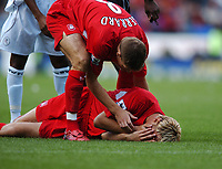 Steven Gerrard attends to Sami Hypia (Injury to face)<br /> Liverpool 2004/05<br /> Bolton Wanderers v Liverpool 29/08/04<br /> The Premier League<br /> Photo Robin Parker Fotosports International<br /> NORWAY ONLY
