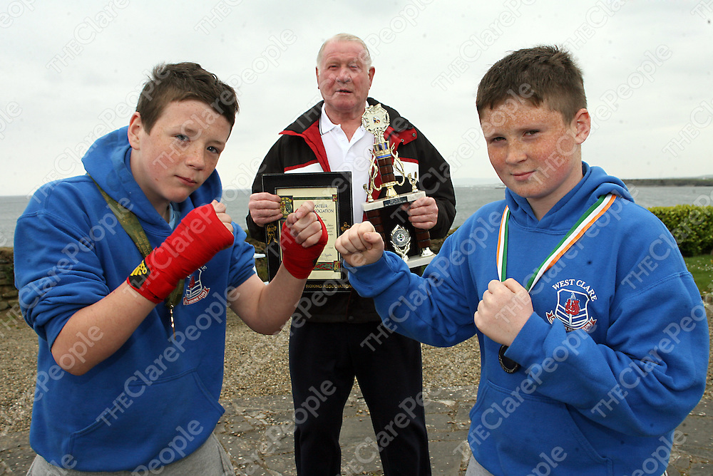 Members of the West Clare Amateur Boxing Club and cousins Keelan Sexton who won the title of National Boy I Champion 54KG in Dublin and Ross Burke who made it to the Munster Final in Limerick with grandfather Martin Sexton in Quilty on Wednesday.<br /> Photograph by Yvonne Vaughan