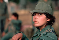 March 1983, Las Palmas, El Salvador --- Female Guerilla Fighter --- Image by © Owen Franken/CORBIS