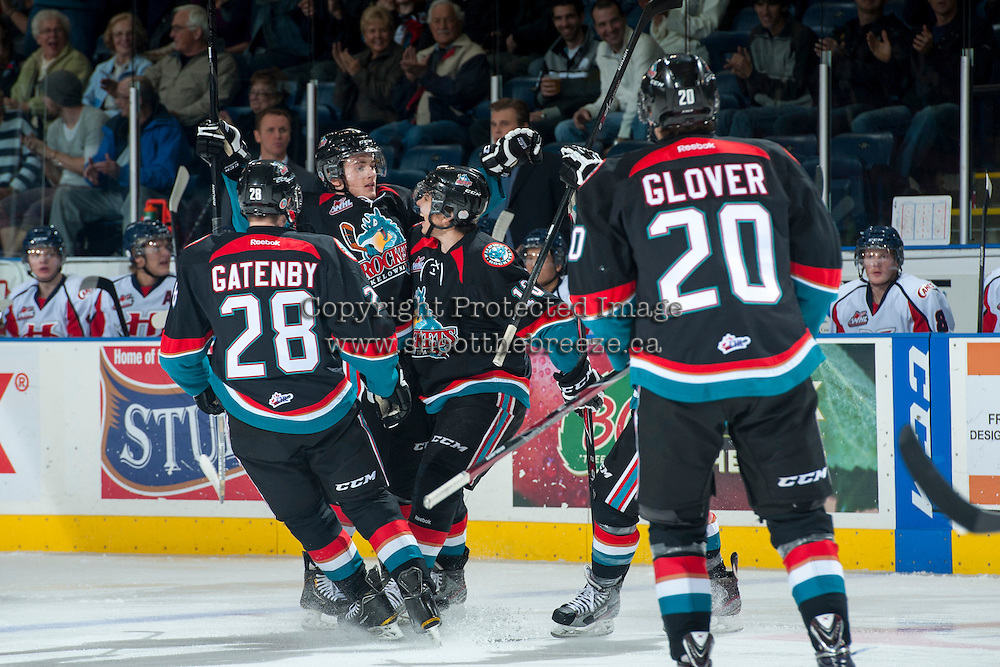 KELOWNA, CANADA, OCTOBER 16 - Riley Stadel #3 of the Kelowna Rockets celebrates a goal with teammates against the Lethbridge Hurricanes on Wednesday, October 16, 2013 at Prospera Place in Kelowna, British Columbia (photo by Marissa Baecker/Getty Images)***Local Caption***
