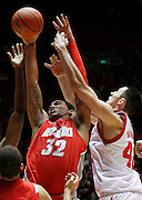 New Mexico forward Drew Gordon (32) and Utah center Jason Washburn (42) battle for a rebound during the second half of an NCAA college basketball game, Wednesday, Jan. 19, 2011, in Salt Lake City, Utah. Utah defeated New Mexico 82-72. (AP Photo/Colin E Braley)