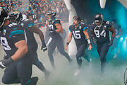 Jacksonville Jaguars Quarterback Gardner Minshew (15) Jacksonville Jaguars Defensive Lineman Dawuane Smoot (94) during the International Series match between Jacksonville Jaguars and Houston Texans at Wembley Stadium, London, England on 3 November 2019.