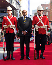 Image ©Licensed to i-Images Picture Agency. 10/06/2014. London, United Kingdom. HRH Prince Harry attends the 50th Anniversary of Zulu premiere. . Picture by Anthony Upton / i-Images<br /> Leicester Square, London, 10 June 2014: The Die Hards re-enactment group with Johnson Beharry VC on the red carpet at a gala screening to celebrate the 50th Anniversary of Zulu where guests were joined by Prince Harry to watch a digitally remastered version of the iconic film. The evening was arranged to raise money for two charities supported by Prince Harry, Walking With The Wounded and Sentebale. <br /> For further info please contact<br /> Emily Conrad-Pickle Captive Minds<br /> Mobile: +44 (0)7799 414 790<br /> emily.conrad-pickles@captiveminds.com