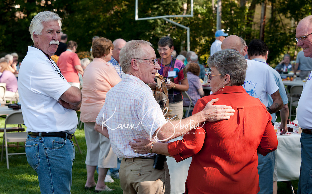 Jeff Reneau and Pat Landry Manley enjoy reminiscing with their fellow classmates from the LHS class of 1961 during the 50th reunion gathering on Sunday afternoon.  (Karen Bobotas/for the Laconia Daily Sun)