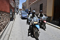Riding through Potosi, Bolivia on motorcycles