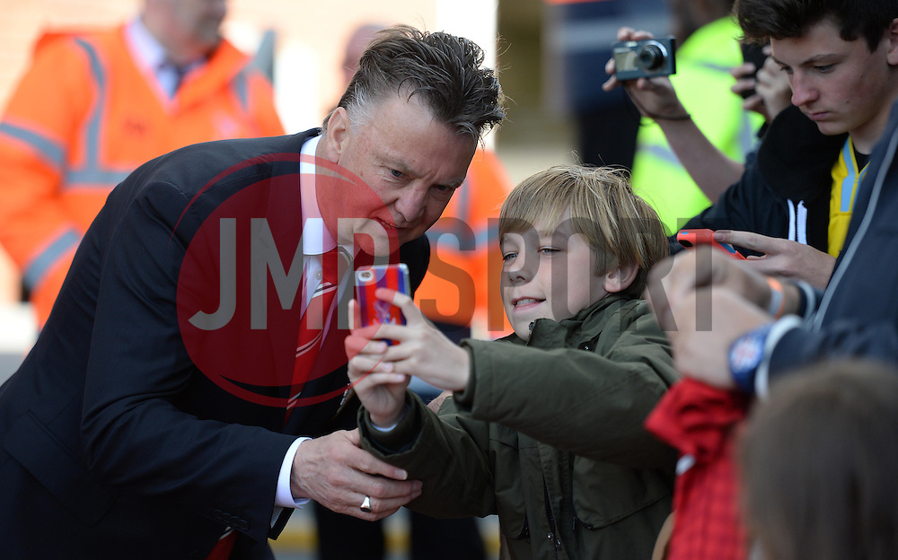 Manchester United Manager, Louis van Gaal has a selfie taken with a fan. - Photo mandatory by-line: Alex James/JMP - Mobile: 07966 386802 - 09/05/2015 - SPORT - Football - London - Selhurst Park - Crystal Palace v Manchester United - Barclays Premier League