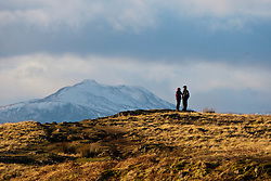 Walkers in the afternoon sunlight on the slope of the Dumyat, a hill at the western extremity of the Ochil Hills, in central Scotland..Pic © Michael Schofield...