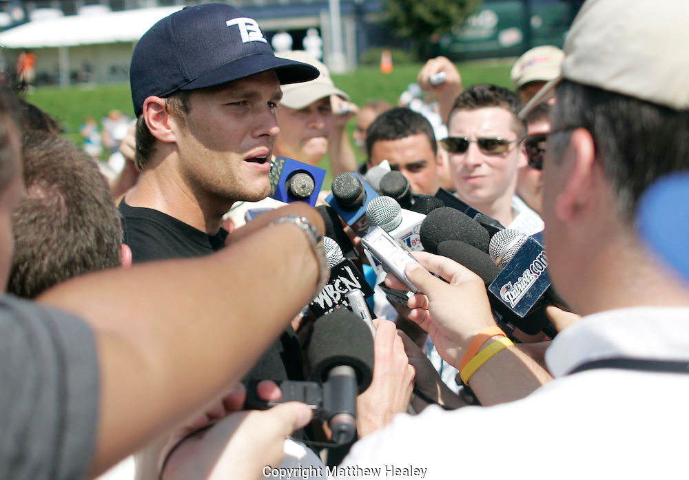 Foxboro, MA - August 11, 2009:  New England Patriots quarterback Tom Brady looks to a reporter during a brief interview following practice at Gillette Stadium.  Photo by Matthew Healey