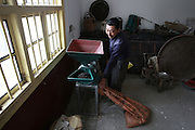 XIANGTAN, CHINA - OCTOBER 29: (CHINA OUT)<br /> <br /> Drinking Faeces Of Cow And Sheep To Treat Cancer<br /> <br /> A man grinds faeces of cows and sheep after drying at Jinshi village on October 29, 2014 in Xiangtan, Hunan province of China. Over 20 families in Jinshi village prevent and treat disease by drinking water of faeces from cows and sheep because a local elder woman said that faeces of cow and sheep through drying, toasting, grinding and then giving water to drink can prevent and treat disease and her cancer got better after drinking for eight months. <br /> ©Exclusivepix