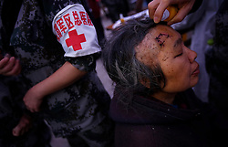 A Chinese woman injured in the earthquake is seen receiving treatment for her injury in a makeshift hospital in Taiping town of Lushan County, Sichuan Province, China, 23 April 2013. The Lushan Earthquake in Sichuan Province on 20 April 2013 resulted in 186 people dead, 21 missing, 11248 injured. About 1.72 million people were affected by the quake, while an initial estimate by the International Red Cross on Saturday put the number needing emergency shelter, water and food at 120,000. The China Earthquake Administration (CEA) recorded a magnitude 7.0 earthquake, while the US Geological Survey said it had measured 6.9.