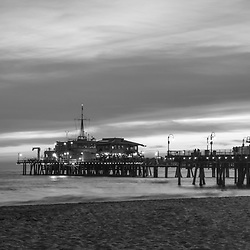 Santa Monica Pier sunset black and white panorama photography. Santa Monica Pier is along the Pacific Ocean in Southern California in the United States. Panoramic photo ratio is 1:3. Copyright ⓒ 2017 Paul Velgos with All Rights Reserved.