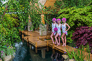 Synchronised Swimmersd in the M&G Garden - The Retreat. RHS Chelsea Flower Show, Chelsea Hospital, London UK, 18 May 2015.