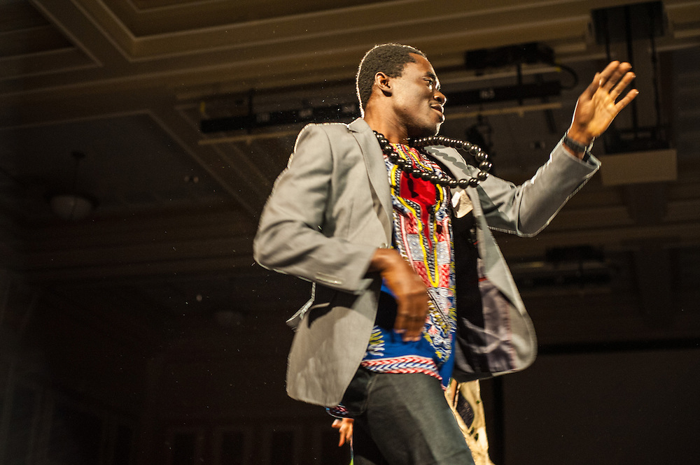 Mustapha Braimah, a 1st year graduate student dances at the International Dinner in Baker University Ballroom on Saturday, November 17, 2012. Students of many different races and religions game together to enjoy one night of multicultural food and entertainment.
