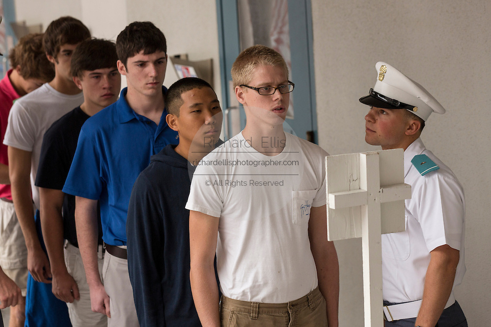 Incoming Citadel freshman known as knobs line up watched by upperclassmen during matriculation day on August 17, 2013 in Charleston, South Carolina. The Citadel is a state military college that began in 1843.