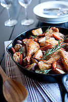 Slow roasted chicken cacciatore braised in San Marzano tomatoes and white wine with potatoes and carrots.