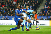 Manchester City striker Gabriel Jesus (33) and Leicester City defender Wes Morgan (5) during the Premier League match between Leicester City and Manchester City at the King Power Stadium, Leicester, England on 18 November 2017. Photo by John Potts.