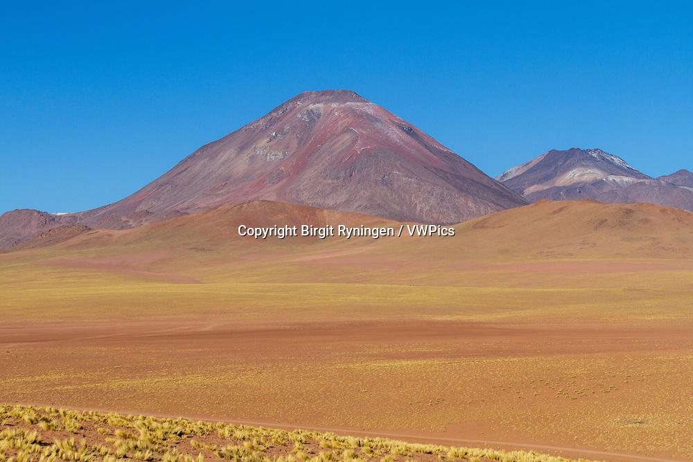 Andean landscape, dotted with volcanos. Location: Between San Pedro de Atacama and El Tatio geysir field, in the Atacama desert, north Chile