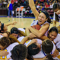 Valley Sanders Pirate Mariah Soria (34) cheers as she and her teammates collapse on center court to celebrate their state championship win over the Rock Point Cougars Saturday at the Prescott Valley Event Center.