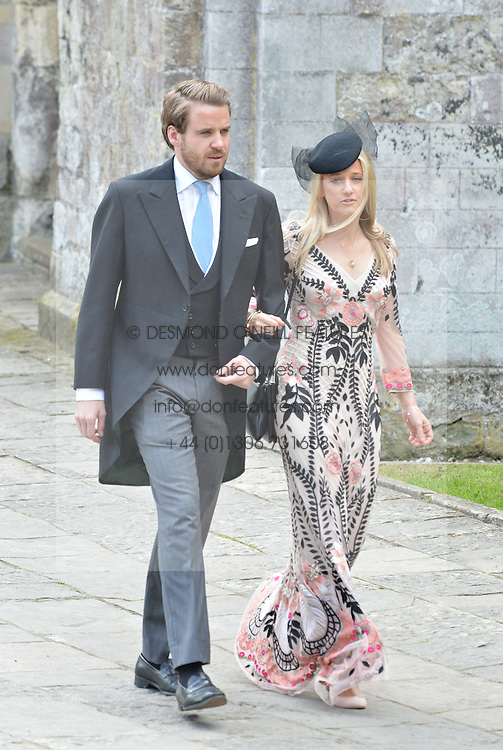 EDWARD & CHRISTABEL LAWSON-JOHNSTON at the wedding of the Hon.Alexandra Knatchbull to Thomas Hooper held at Romsey Abbey, Romsey, Hampshire on 25th June 2016