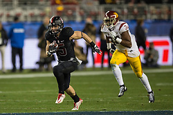 SANTA CLARA, CA - DECEMBER 05:  Running back Christian McCaffrey #5 of the Stanford Cardinal rushes up field past linebacker Olajuwon Tucker #34 of the USC Trojans during the third quarter of the Pac-12 Championship game at Levi's Stadium on December 5, 2015 in Santa Clara, California. The Stanford Cardinal defeated the USC Trojans 41-22. (Photo by Jason O. Watson/Getty Images) *** Local Caption *** Christian McCaffrey; Olajuwon Tucker