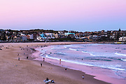 Bondi Beach, Sydney, Australia with a pink sunset.