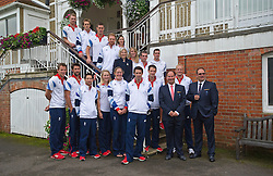 © London News Pictures. 25/08/2012. Henley-on-Thames, UK. Home Secretary Theresa May with Members of the Team GB Rowing squad before they take part in a 'Heroes Return' Open-top bus tour through the town of Henley-on-Thames in Oxfordshire on August 25, 2012. The GB rowing squad won a total of nine medals at the 2012 London Olympics including four golds.  Photo credit : Ben Cawthra/LNP