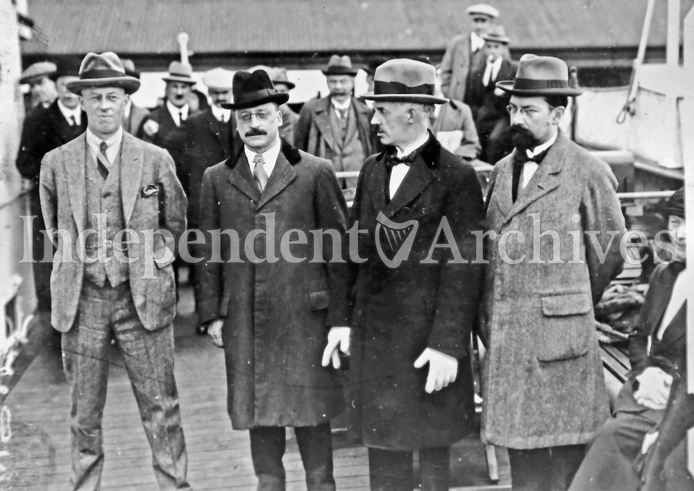 Members of the Irish delegation at Kingstown (Dun Laoghaire) en route to London as part of the negotiations that led to the Anglo-Irish Treaty of December 1921. L-R: Robert Barton, Arthur Griffith, Eamon Duggan, Gavan Duffy. (Part of the Independent Newspapers Ireland/NLI Collection)