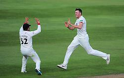 Craig Overton and Roelof Van De Merwe of Somerset celebrate the wicket of Samit Patel.  - Mandatory by-line: Alex Davidson/JMP - 22/09/2016 - CRICKET - Cooper Associates County Ground - Taunton, United Kingdom - Somerset v Nottinghamshire - Specsavers County Championship Division One