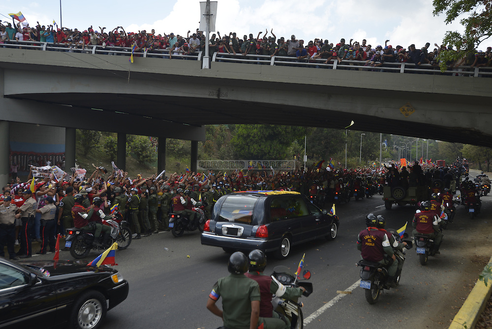 CARACAS - MARCH 15, 2012: Thousands of people fallow the funeral motorcade carrying the remains of Venezuelan President Hugo Chavez who died past March 5 after a fight against cancer lasted two years. (Photo by Gregorio Marrero/LatinContent/Getty Images)