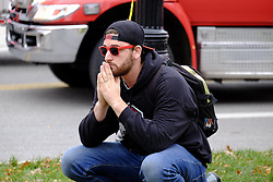 November 28, 2016 - USA - Shooting witness and student Nicholas Flores prays near the intersection of Woodruff and College on Ohio State's campus during an active shooter situation on Nov. 28, 2016 in Columbus, Ohio. (Credit Image: © Adam Cairns/TNS via ZUMA Wire)