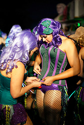 29 January 2016. New Orleans, Louisiana.<br /> Dancers prepare for The Krewe of Cleopatra to kick off the main parading season of Mardi Gras in New Orleans with floats filled with riders dispensing beads and throws, marching bands and dance troupes. Families line the streets Uptown to cheer on Cleopatra - 'Throw me something Mister!'<br /> Photo©; Charlie Varley/varleypix.com
